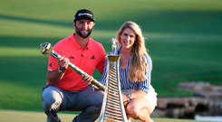 Jon Rahm of Spain celebrates with his fiancee, Kelley Cahill, after winning the Final of the Dubai DP World Tour Championship in the United Arab Emirates