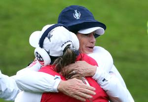 Team USA captain Juli Inkster (right) celebrates with Lizette Salas on the 17th during the fourballs at Gleneagles (Jane Barlow/PA)
