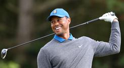Tiger Woods will be up first in the Presidents Cup (Niall Carson/PA)