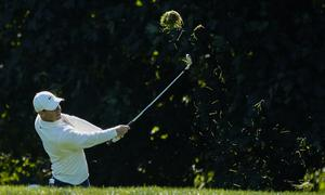 Rory McIlroy hits out of the rough on the 14th hole during the third round of the US Open (Charles Krupa/AP)