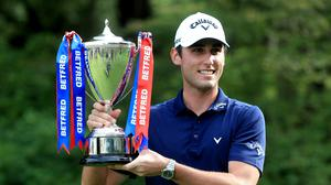Italy's Renato Paratore celebrates with the trophy after winning the Betfred British Masters (Mike Egerton/PA)