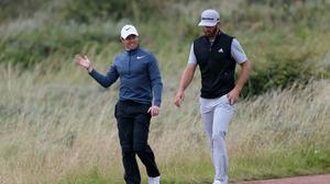 Rory McIlroy, left, will team up with Dustin Johnson for a charity event later this month (Richard Sellers/PA)