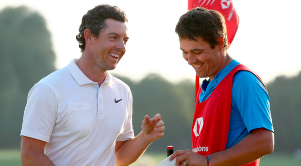 Pals act: Rory McIlroy and caddy Harry Diamond celebrate the moment of victory in China