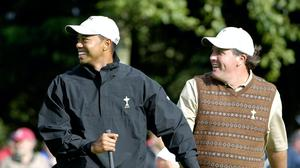 Tiger Woods and Phil Mickelson will face each other again (PA)