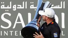 Graeme McDowell celebrates with the trophy after winning the Saudi International (AP Photo/Amr Nabil)