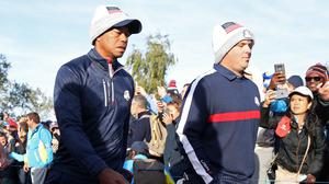 Patrick Reed, right, struggled in partnership with Tiger Woods (Adam Davy/PA)