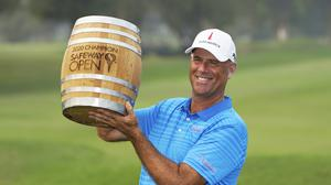 Stewart Cink lifts his trophy on the 18th green of the Silverado Resort North Course after winning the Safeway Open PGA golf tournament (Eric Risberg/AP)