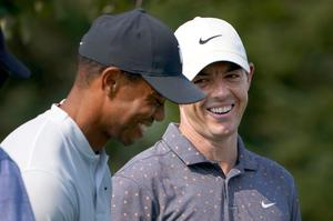 Smiles better: Rory McIlroy and Tiger Woods during a practice round yesterday