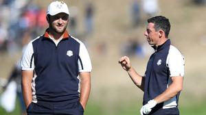 Jon Rahm (left) has replaced Rory McIlroy as the world's number one golfer.