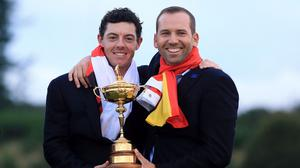 Sergio Garcia, right, has no problem with Rory McIlroy, left, winning with an event to spare