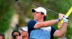 Great start: Rory McIlroy on way to a 64 at the DP World Tour Championship in Dubai yesterday