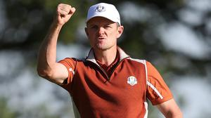 Team Europe's Justin Rose celebrates a birdie on the 13th during the Foursomes match on day two of the Ryder Cup at Le Golf National, Saint-Quentin-en-Yvelines, Paris.