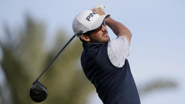 Andrew Landry follows through on a shot from the ninth tee during the third round of The American Express golf tournament in La Quinta, California (Alex Gallardo/AP)