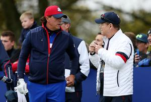 USA's Phil Mickelson chats with captain Tom Watson during a practice session at Gleneagles Golf Course, Perthshire (David Davies/PA)