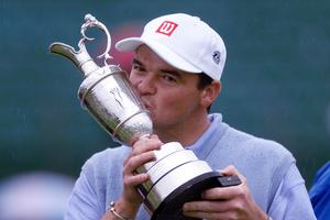 Scotland's Paul Lawrie kisses the trophy after winning the 1999 Open Championship (Ben Curtis/PA)