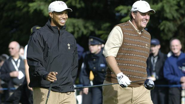 Tiger Woods (left) teamed up with Peyton Manning to beat Phil Mickelson (right) and Tom Bray in a charity match to raise money for Covid-19 relief.