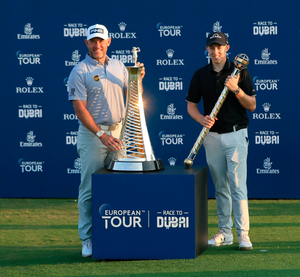 Lee Westwood who poses with the Race to Dubai trophy