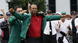 Tiger Woods dons the Green Jacket for a fifth time (David J Phillip/AP).