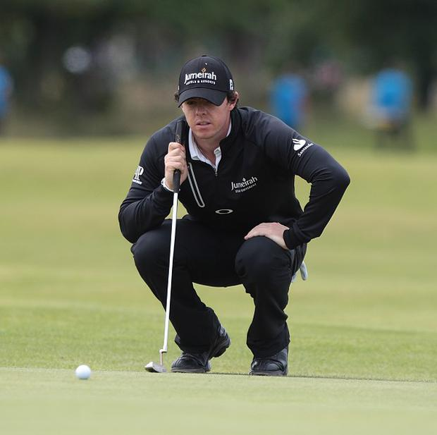 Rory McIlroy, pictured, faces Shane Lowry in Wednesday's opening round of the WGC-Accenture Match Play Championship