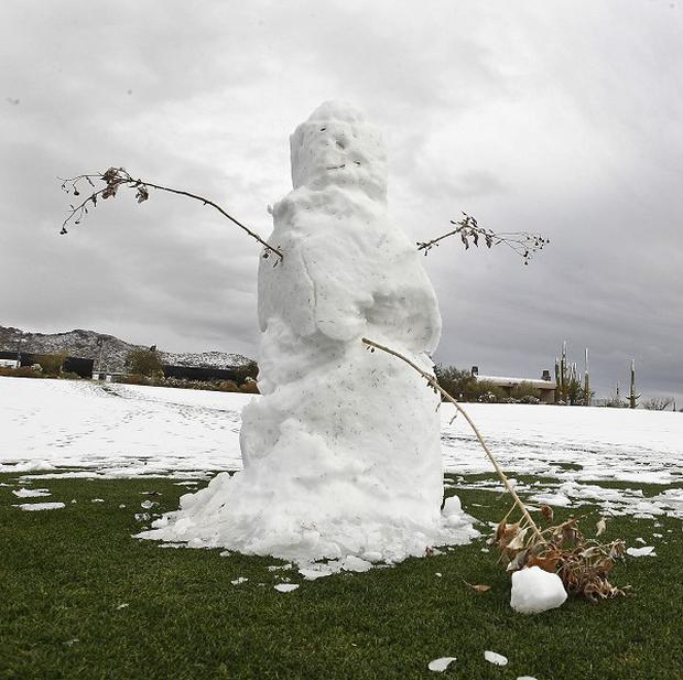 A snowman stands on the fairway after snow stopped play in Arizona (AP)