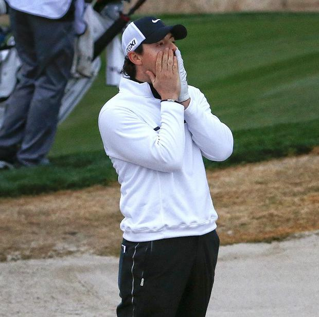 Rory McIlroy, pictured, lost on the final green to Shane Lowry at the Accenture Match Play Championship (AP)
