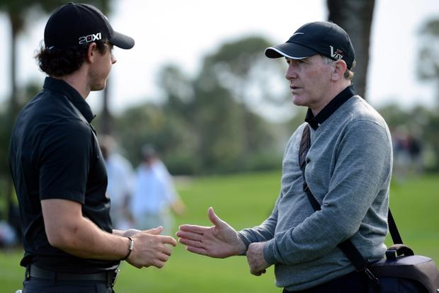PALM BEACH GARDENS, FL - FEBRUARY 27: Rory McIlroy of Northern Ireland talks with his coach Michael Bannon during the pro am of the Honda Classic at PGA National on February 27, 2013 in Palm Beach Gardens, Florida. (Photo by Stuart Franklin/Getty Images)