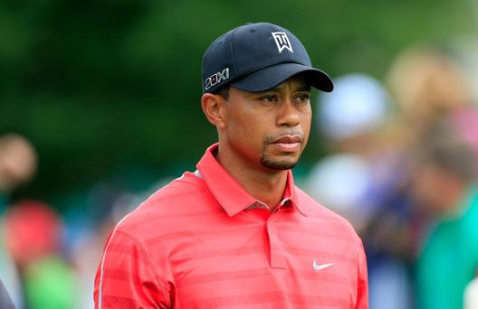 ORLANDO, FL - MARCH 24: Tiger Woods of the United States on the tee at the par 4, 1st hole during the final round of the 2013 Arnold Palmer Invitational Presented by Mastercard at Bay Hill Golf and Country Club on March 24, 2013 in Orlando, Florida. (Photo by Sam Greenwood/Getty Images)