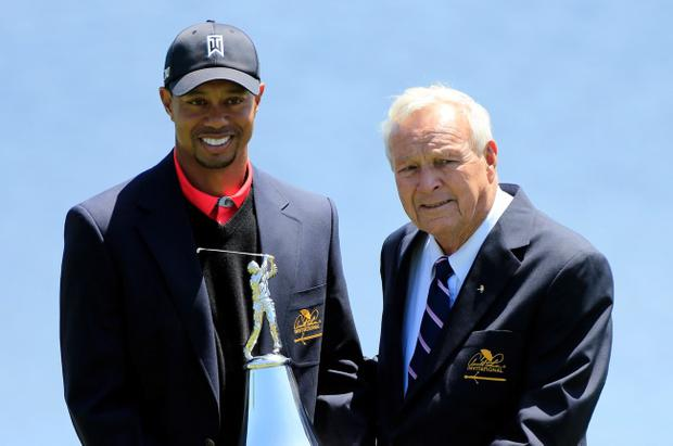 ORLANDO, FL - MARCH 24: Tiger Woods (L) and Arnold Palmer laugh during the ceremony following the Arnold Palmer Invitational presented by MasterCard at the Bay Hill Club and Lodge on March 24, 2013 in Orlando, Florida. (Photo by Sam Greenwood/Getty Images)