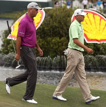 Stewart Cink, left, and Bill Haas share the lead going into the final round of the Houston Open (AP)
