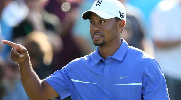 AUGUSTA, GA - APRIL 10: Tiger Woods of the United States watches a shot during a practice round prior to the start of the 2013 Masters Tournament at Augusta National Golf Club on April 10, 2013 in Augusta, Georgia. (Photo by Andrew Redington/Getty Images)