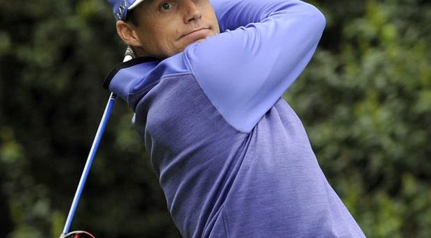 Nick Watney, pictured, and Phil Mickelson lead the Wells Fargo Championship on eight under par (AP)