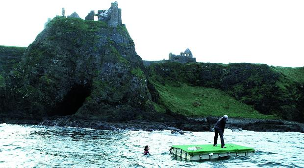 Gareth Maybin attempts the impossible shot at Dunluce Castle, County Antrim