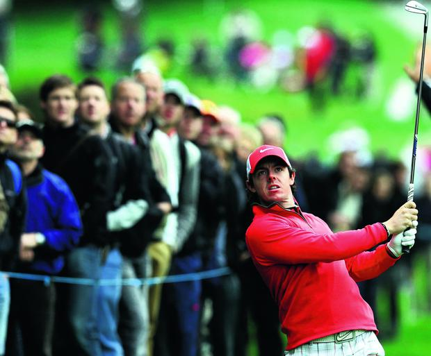 VIRGINIA WATER, ENGLAND - MAY 23: Rory McIlroy of Northern Ireland hits an approach during the first round of the BMW PGA Championship on the West Course at Wentworth on May 22, 2013 in Virginia Water, England. (Photo by Julian Finney/Getty Images)