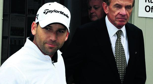 Sergio Garcia of Spain emerges from a meeting in the rules office with George O'Grady at Wentworth