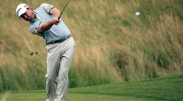Graeme McDowell of Northern Ireland plays into the 12th green during the first round of the Alstom Open de France at Le Golf National on July 4, 2013 in Paris, France.