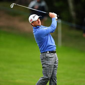 Graeme McDowell, pictured, shares the lead with Richard Sterne in Paris