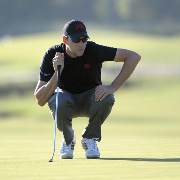 Matthew Fitzpatrick and Neil Raymond, pictured, won the par-five 18th (AP)