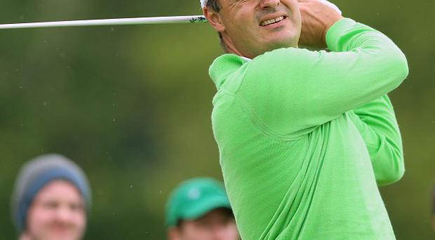 England's Simon Khan was forced to withdraw from the Seve Trophy on Sunday due to a back injury.