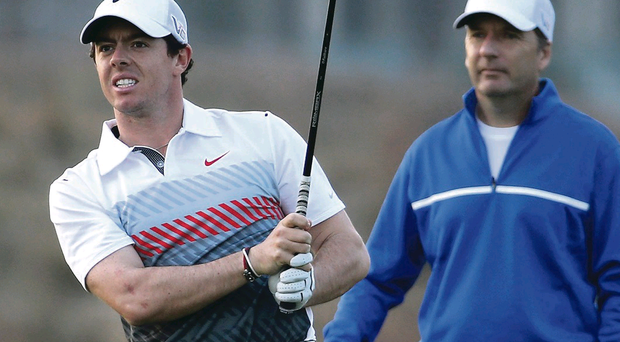 Warm-up: Rory McIlroy plays a shot during the Pro-Am at Lake Malaren in Shanghai