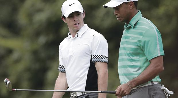 Rory McIlroy and Tiger Woods talk golf on their round in China