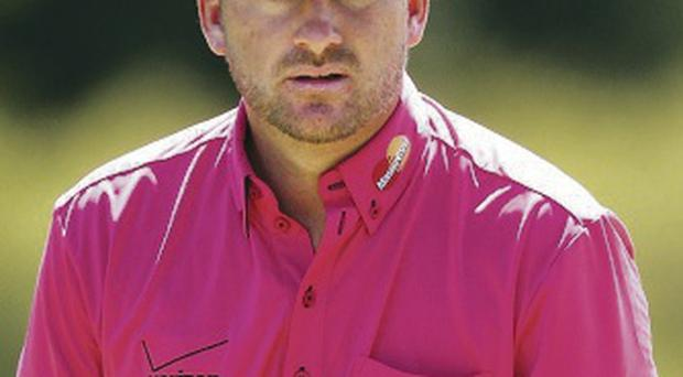 Off colour: Graeme McDowell is out of form in Melbourne