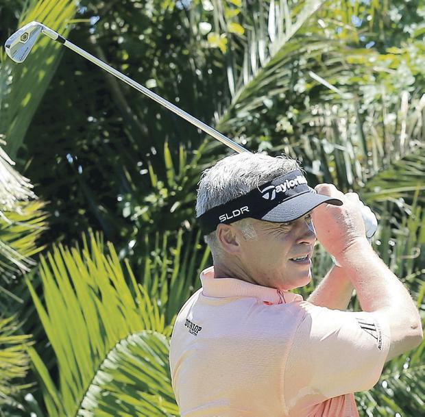 Darren Clarke, in action during his practice round in Durban yesterday, has lost over 40 pounds