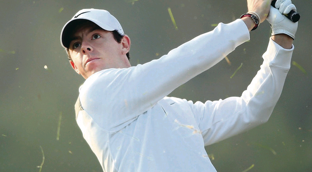 Rory McIlroy plays his second at 13 yesterday in first round of Abu Dhabi Championship
