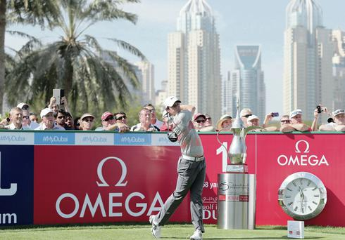 Rory McIlroy tees off on first hole at Champions Challenge yesterday ahead of Dubai Desert Classic which starts tomorrow