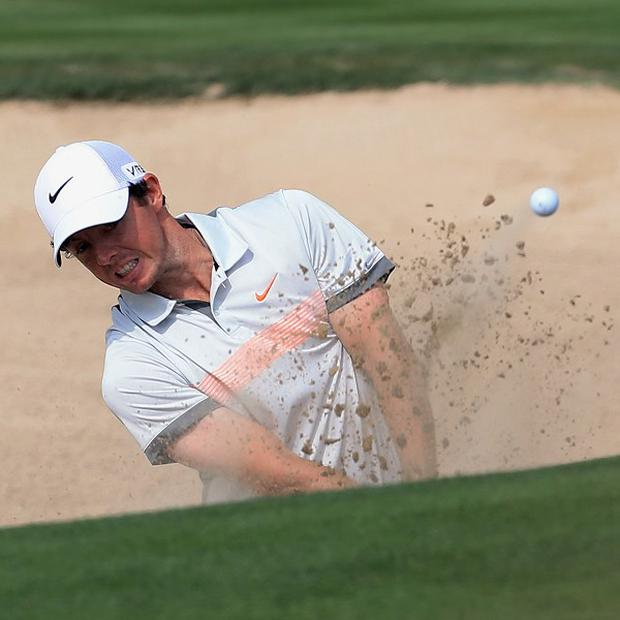 Rory McIlroy, pictured, lost the lead in Dubai to playing partner Brooks Koepka (AP)