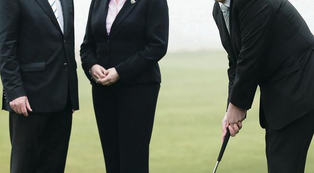 At Royal County Down are George O'Grady, the Chief Executive of The European Tour, First Minister Peter Robinson and Enterprise Minister Arlene Foster