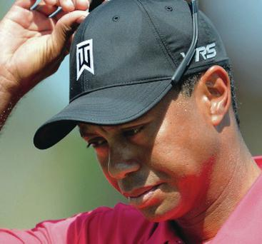 Thinking ahead: Tiger Woods will return later this summer