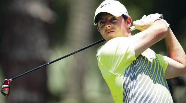Aiming high: Rory McIlroy watches his tee shot on the second hole during the second round of The Players' Championship