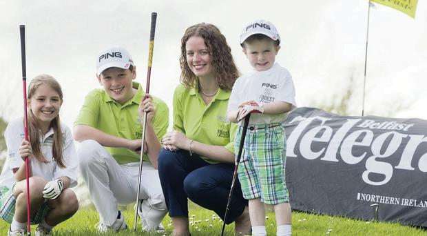 Into the swing: Zoe Miller, Scott Miller, and Harry O'Hara join Forest Feast marketing manager Deirdre Burns at the launch of the 2014 Forest Feast Junior Golf Festival at The Blackwood