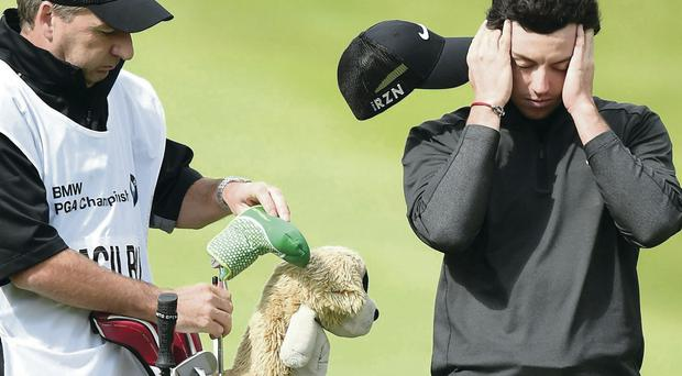 Keeping focus: Rory McIlroy has been distracted by his split from Caroline Wozniacki but yesterday tries to concentrate at Wentworth